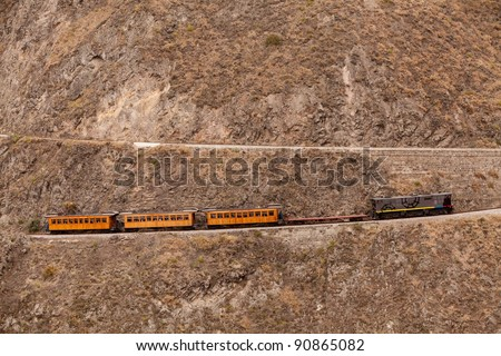 Train going up on Nariz del Diablo, very important tourist attraction in Ecuadorian Andes, one of the highest railorad route in the world - stock photo