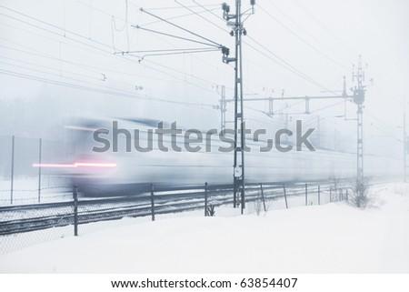Train in heavy snow storm - stock photo