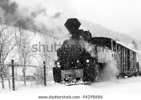 TRAIN IN MARAMURES FOREST, winter time - stock photo