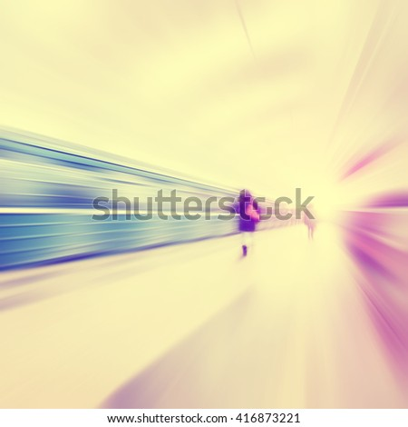 Train in motion blur and blurred people in subway station. Vintage style. - stock photo