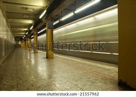 train in motion in subway station, photo taken in new york - stock photo