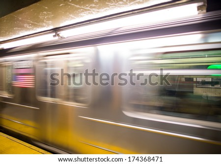 Train in motion inside a subway station, New York. - stock photo
