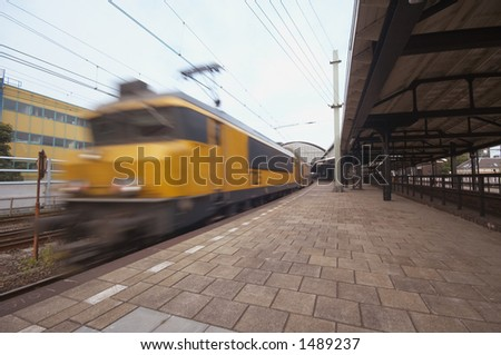 Train in motion on a station in the Netherlands - stock photo