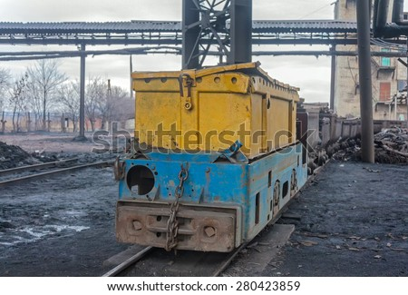 Train in national colors with trolleys in a coal mine. Donbass, Ukraine - stock photo
