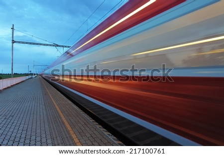 Train in railway at speed - stock photo