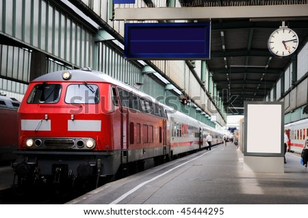 Train in the station with clock - stock photo