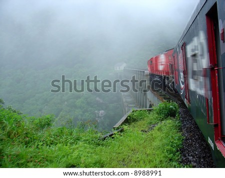 Train in the tropical forest in South of Brazil - stock photo