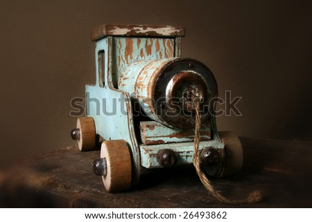 train in wood. child's old vintage locomotive. toy model of engine - stock photo