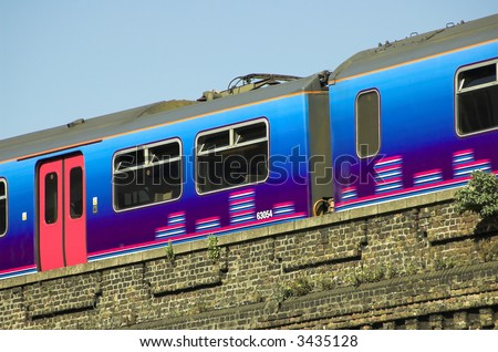 Train leaving Elephant and Castle Station, London - stock photo