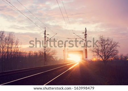 Train light trail on the railroad - stock photo