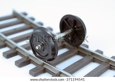Train model wheels. Train wheels on a rail tracks. - stock photo