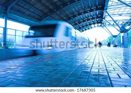 train move on wet platform in subway - stock photo