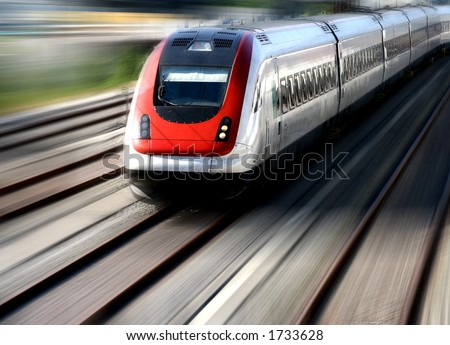 Train moving fast on its tracks. - stock photo
