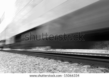 Train moving fast with motion blur. Black and white high-key image - stock photo