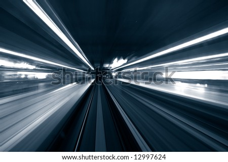 train moving in blue tone ,focus on track - stock photo