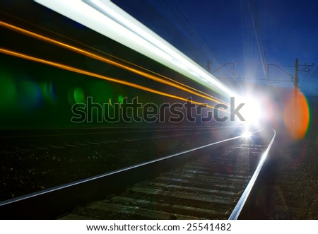 Train moving in the night. - stock photo