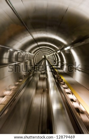 Train Moving in Tunnel at Extreme Speeds - stock photo