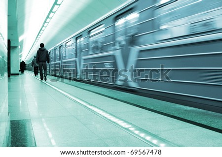 Train moving out of the station - stock photo