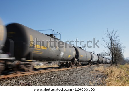 Train of oil tank cars on railroad - stock photo