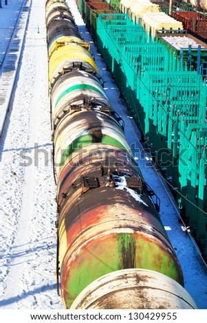 Train of wagons with oil tanks - stock photo