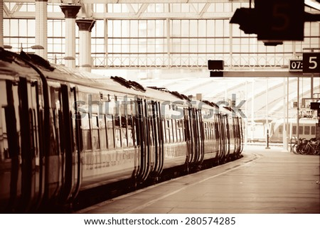 Train on platform in station in London - stock photo