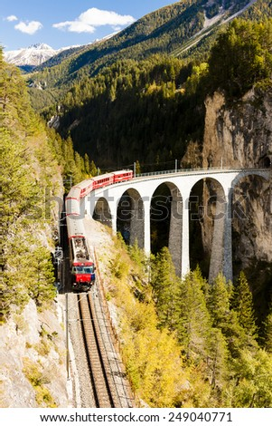 train on Rhaetian Railway, Landwasserviadukt, canton Graubunden, Switzerland - stock photo