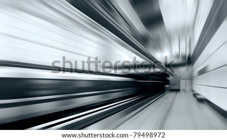 Train on speed in railway station - stock photo