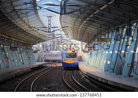 train on the railway approaching Xike station - stock photo
