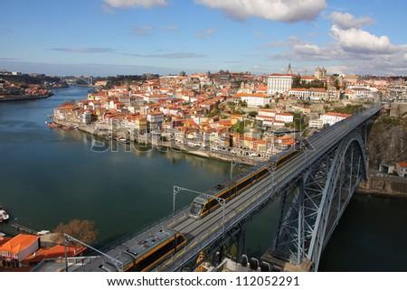 Train over Dom Luis I bridge, Porto, Portugal - stock photo