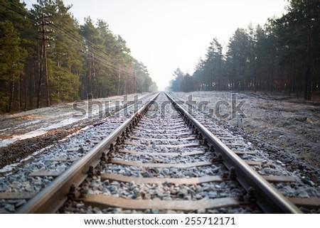 Train rails in winter time, Poland - stock photo
