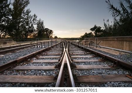 Train rails sunset - stock photo
