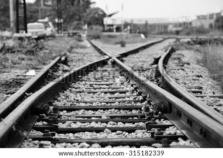 Train railway railroad track for junction in black white background  - stock photo