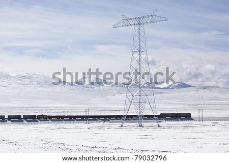 train running on the altiplano in the northwest of china - stock photo