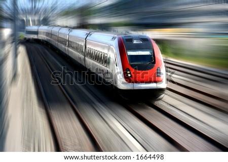 Train speeding along its tracks. Motion blur. - stock photo