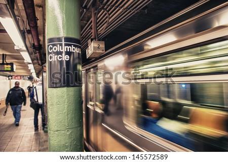 Train speeding up in Columbus Circle subway station - NYC. - stock photo