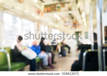 Train station with people blurred - stock photo