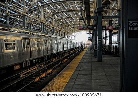 Train stopped at the Coney Island Subway Station - stock photo