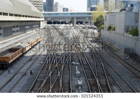 train track leading to the station - stock photo