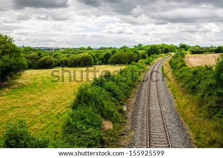 Train track through the Irish countryside - stock photo