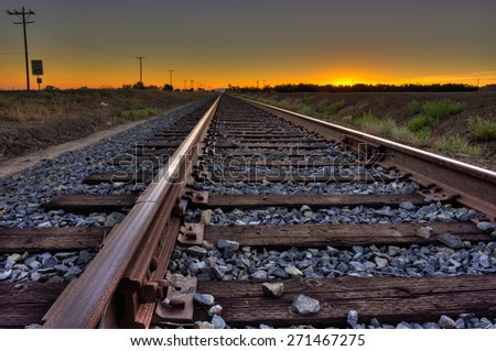 Train track to the sunset