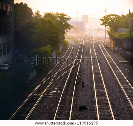 Train tracks at dawn in western Cambridge, Massachusetts - stock photo