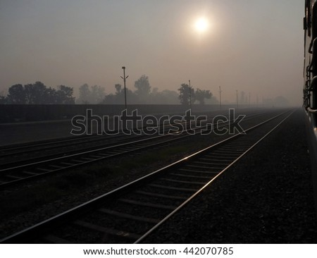 train tracks at the early morning mist with train window
