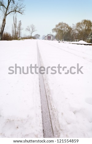 Train tracks covered with snow - stock photo