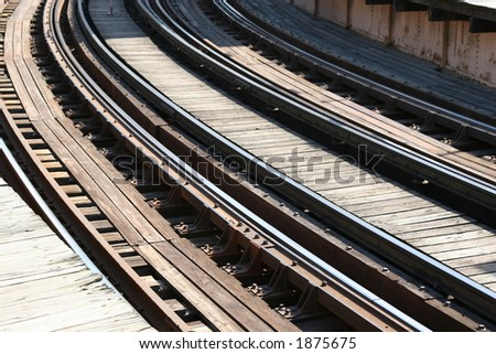 Train Tracks entering a curve - stock photo