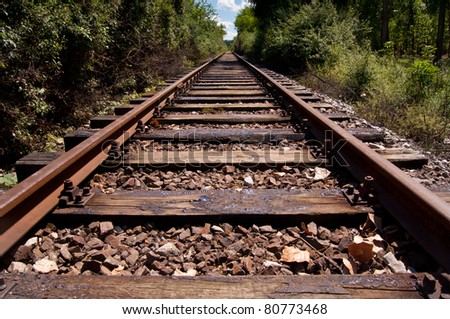Train tracks going into the horizon - stock photo