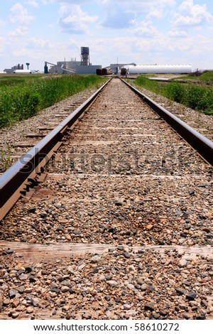 Train tracks leading to a potash mine in central Canada. - stock photo