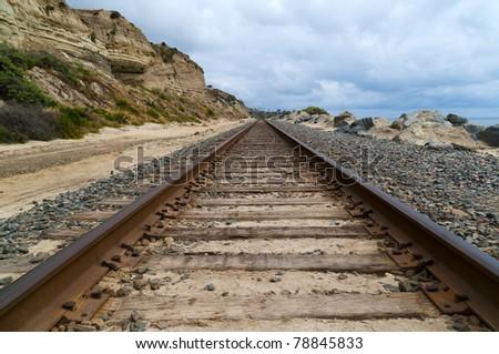 Train tracks on the coast of a Californa beach - stock photo
