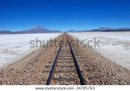 train tracks to the horizon - stock photo