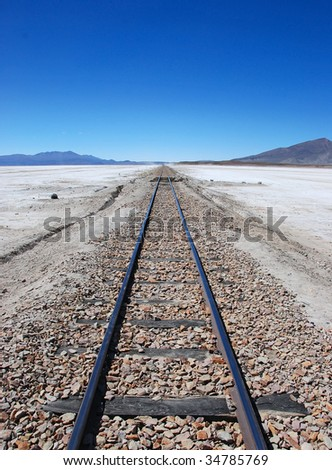 train tracks to the horizon - stock photo