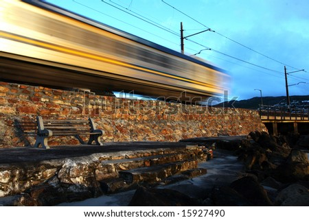 Train traveling at speed. - stock photo
